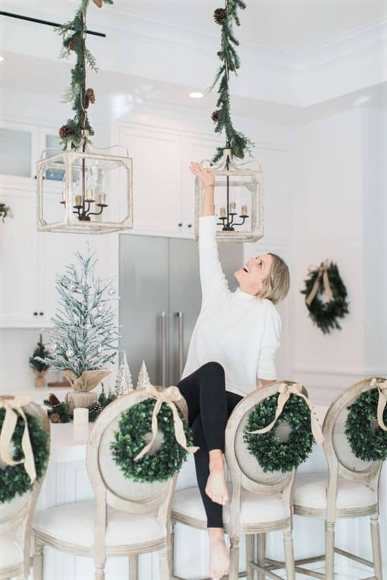Mini Wreaths on the back of chairs Christmas decorating idea
