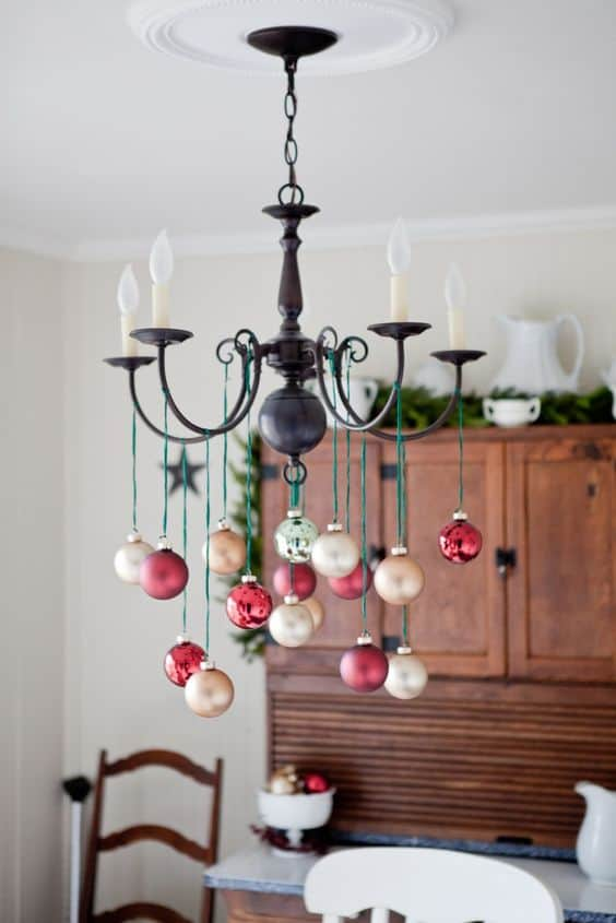 Easy DIY hanging ornament chandelier Christmas decor idea using dollar store ornaments and ribbon. Elegant Christmas decoration idea for mantle, window, ceiling, or wall. Great budget decor idea for the home, winter wedding, or Christmas party.