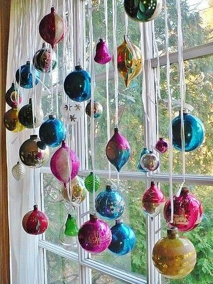 Easy DIY hanging window ornaments using ribbon. Elegant Christmas decoration idea for mantle, window, ceiling, or wall. Great budget decor idea for the home, winter wedding, or Christmas party.