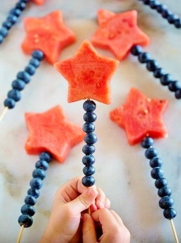 Easy DIY 4th of July Party ideas. Red White and Blue fruit skewers #Patriotic #4thofJuly