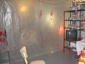 Easiest, best, and most creative Halloween party decorations that'll keep guests out using plastic sheets and acrylic paint.