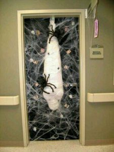 The Best Creative Halloween Decor that'll keep guests out using guaze , webs and spiders. Great dollar store idea.