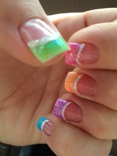 Use Sharpie Highlighters on glitter polish to make these rainbow nails in minutes. perfect spring, easter, and summer nail art design.