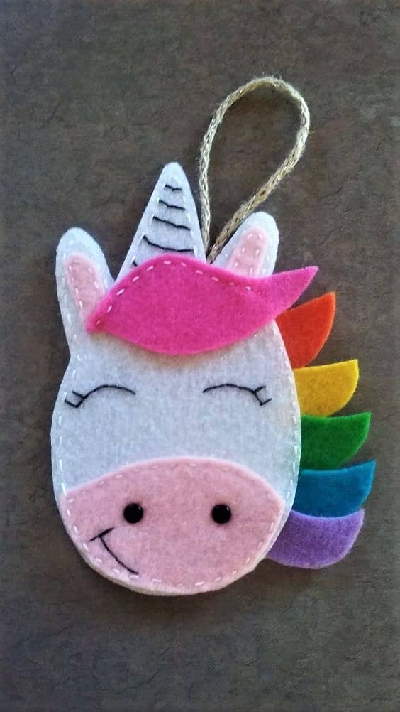Easy DIY Felt Unicorn Christmas Ornament craft, and gift idea. Great for kids, teens, friends, teachers, and an ornament making party.