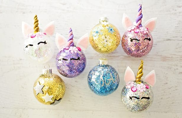 Easy DIY Unicorn Glitter Ornaments That Look Professional. They make great gifts and you can customize them with a name and date in the back. So adorable you'll want to keep these for yourself. Cricut projects.