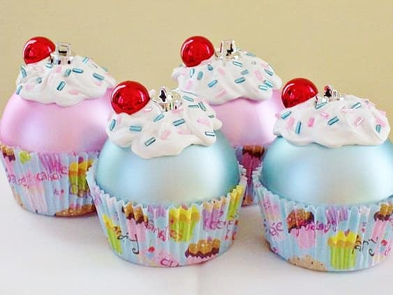 Easy DIY Cupcake Ornaments that look professional. Made from regular ball ornaments, glue, cupcake liners, caulk and beads, you'll actually want to keep these ornaments or give them as gifts.