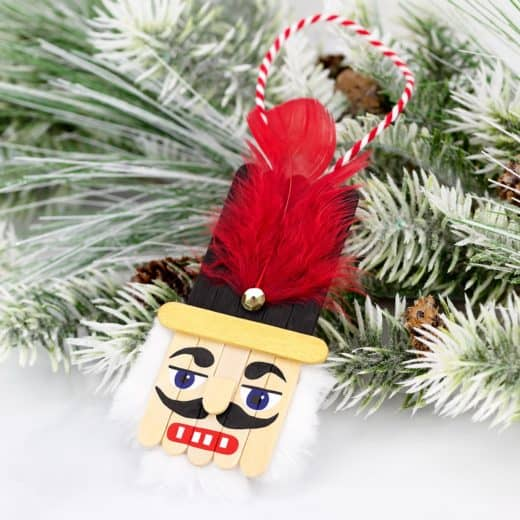 Easy DIY Nutcracker Popsicle Ornament. Simple yet beautiful dollar store craft gift idea anyone can make, even kids.