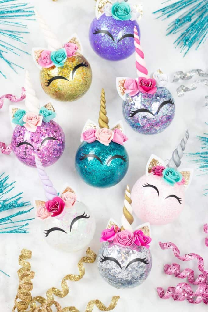 Easy DIY Unicorn Glitter Ornaments That Look Professional. They make great gifts and you can customize them with a name and date in the back. So adorable you'l actually want to keep them. Cricut projects, Cricut Christmas projects.