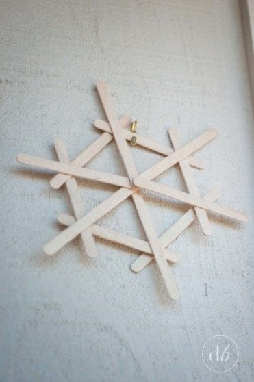 Easy DIY Popsicle Snowflake Christmas Ornament or Winter decoration. Simple yet beautiful dollar store craft gift idea anyone can make, even kids,